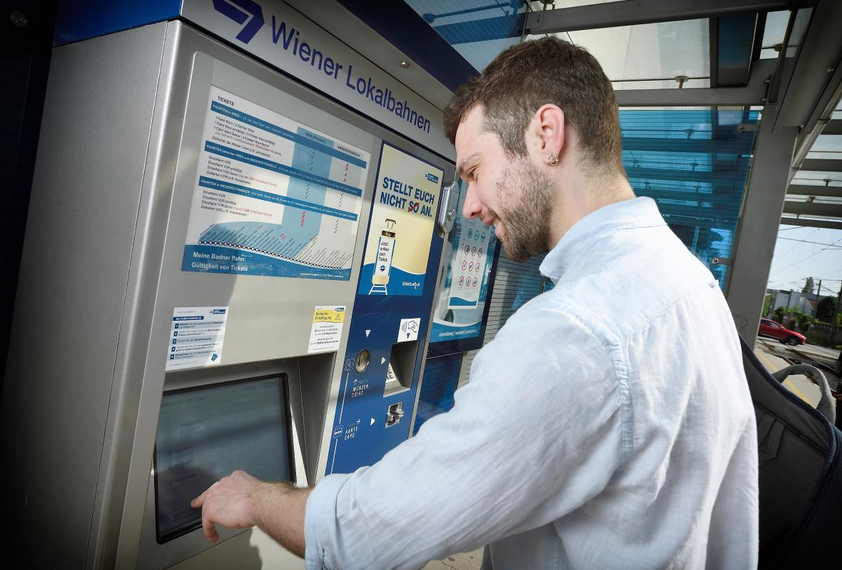 Passenger buying a ticket on a ticket machine
